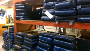 Picture of seat cushions stacked in warehouse.